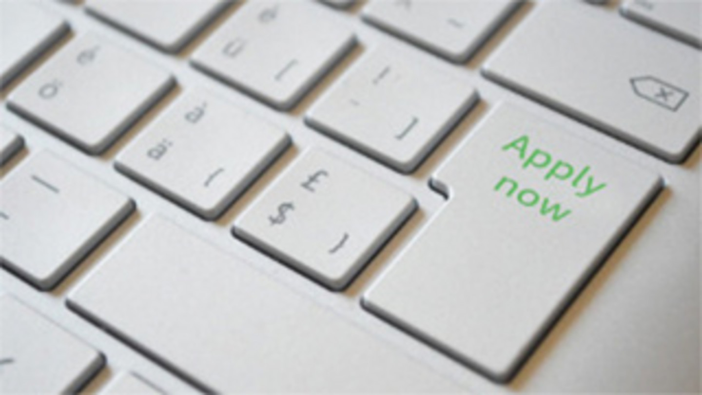 Enter key of a keyboard with green label Apply now